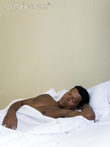 black man sleep in bed