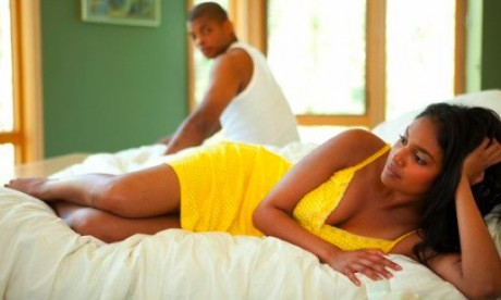 black-couple-laying-on-bed-460x276