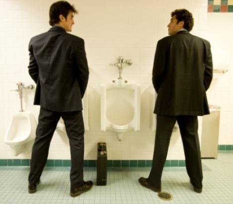 men at bathroom urinal