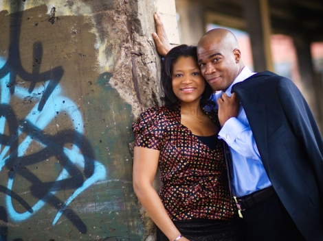 black couple in front of graffiti wall