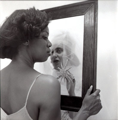black woman seeing bad image in mirror