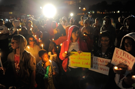 Image: Supporters hold candlelight vigil at exact moment when teenager Martin was shot one year ago in Sanford