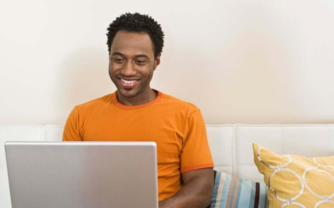 black Man_using_computer_page-bg_13427
