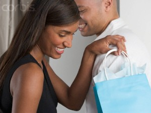 Man giving gifts to woman
