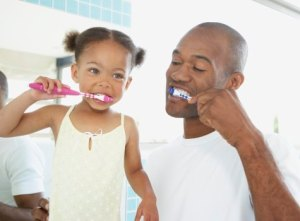 father daughter brushing teeth1