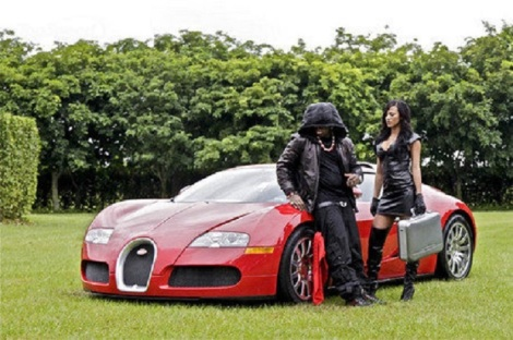 man with bugatti and woman