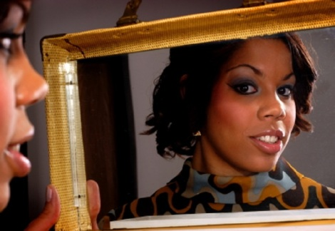 Black woman admiring herself