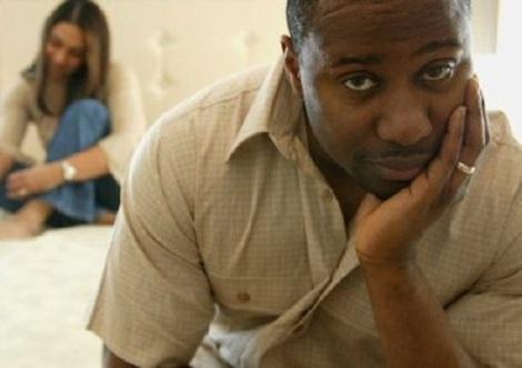 Black man contemplating